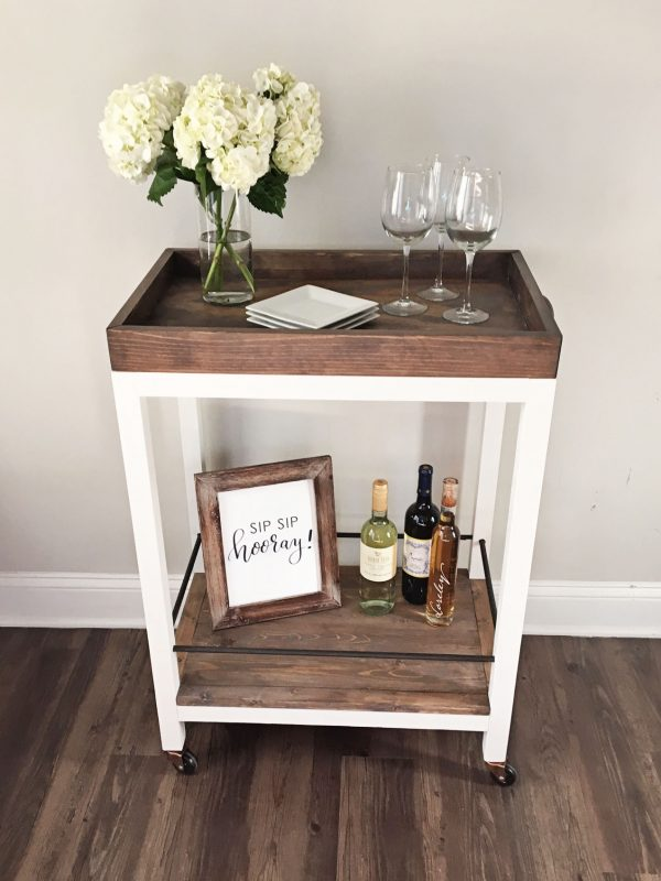 DIY bar cart with flowers, wine, and wine glasses