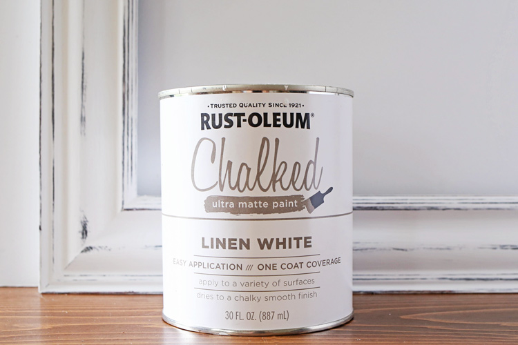 Can of rustoleum chalked paint linen white and pitcture frame