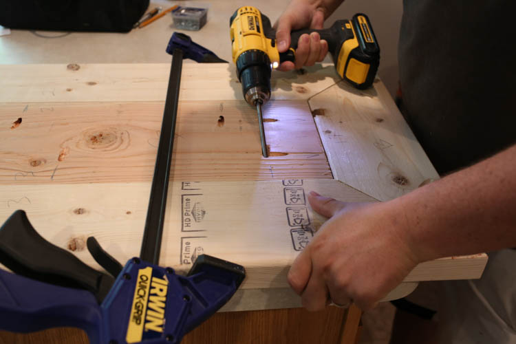 attaching the TV stand top boards together with Kreg screws and drill