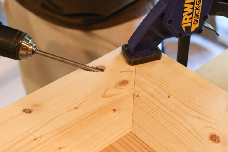 attaching the TV stand top boards together with Kreg screws and drill and clamp