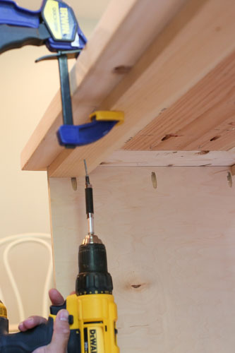 attaching DIY TV stand top to the base with drill and screws