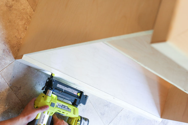 Attaching Bottom trim to DIY TV stand with brad nailer