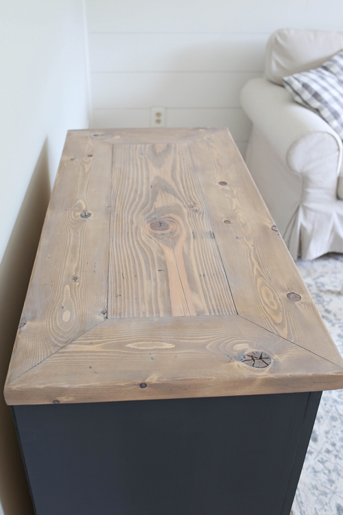Weathered wood finish top of a DIY TV stand