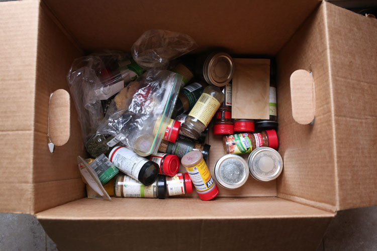 Disorganized Spice Jars in box