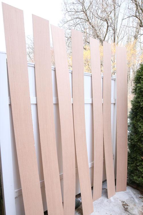 Plywood boards cut into 8 inch shiplap board planks