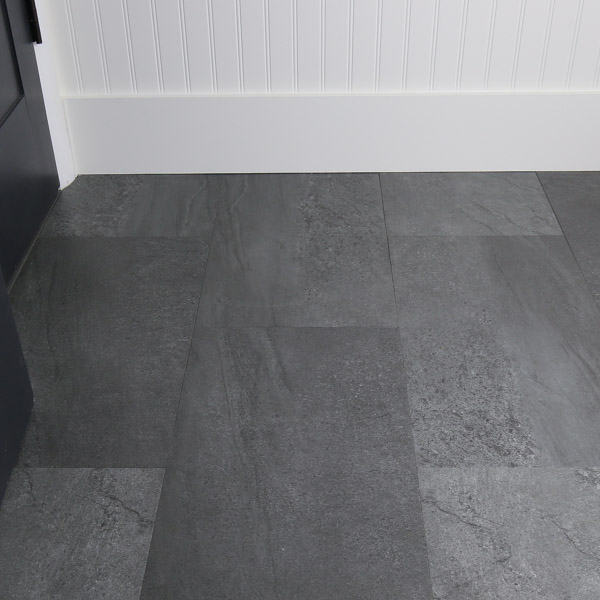 Gray slate luxury vinyl tile in DIY bathroom renovation