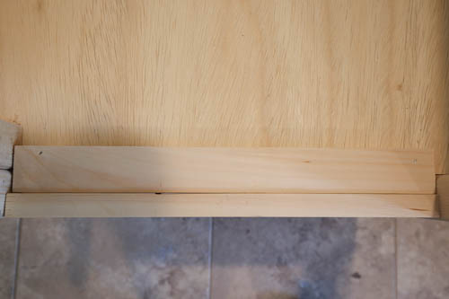 cover gap with scrap wood on vanity base