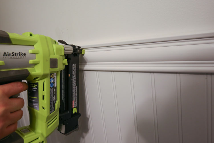 Attach the moulding to the wall with a brad nailer