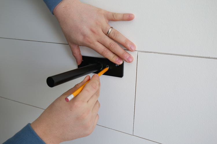 marking holes for steel bracket screws on wall