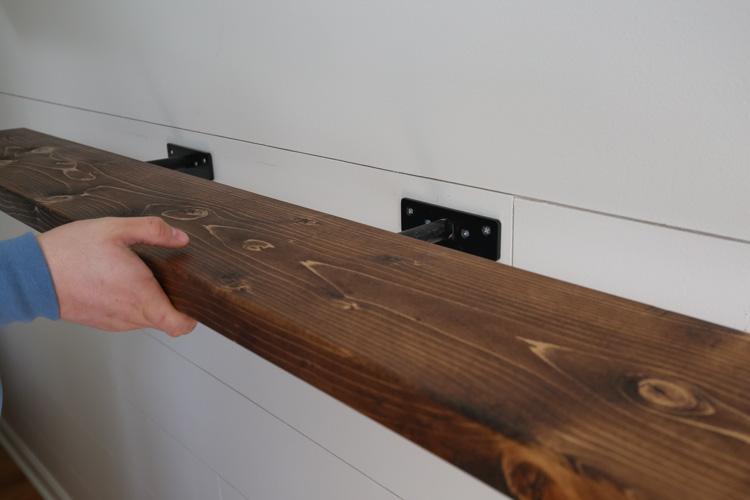 Instaling easy DIY floating shelf on wall brackets