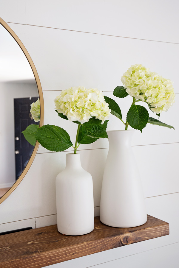 Easy DIY floating shelf with hydrangeas in two vases