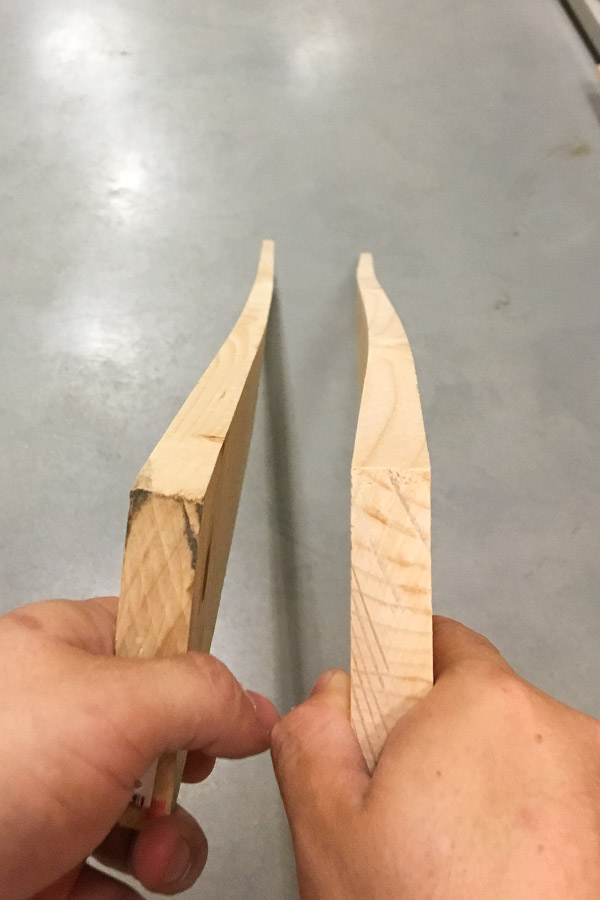 Two wood boards that are warped and bowing