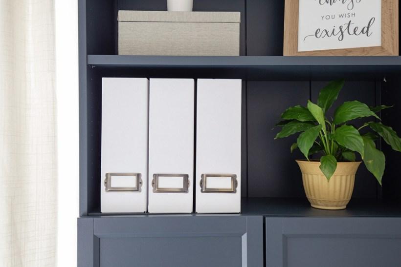 DIY magazine holders on a bookshelf