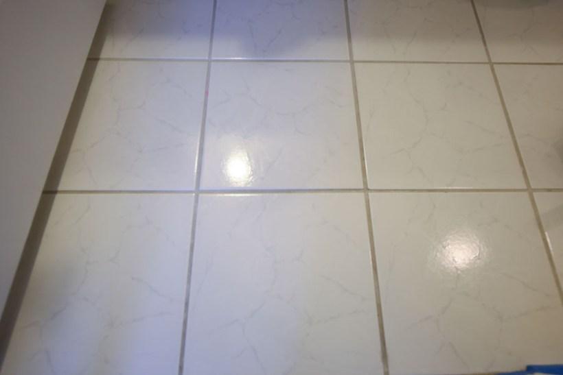 Old bathroom tile floor before painting