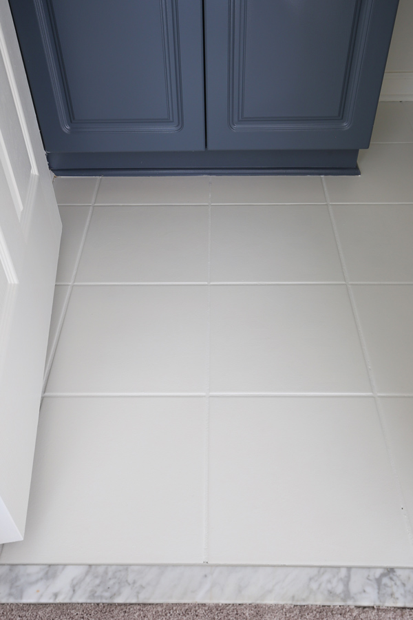 white painted floor tiles in bathroom