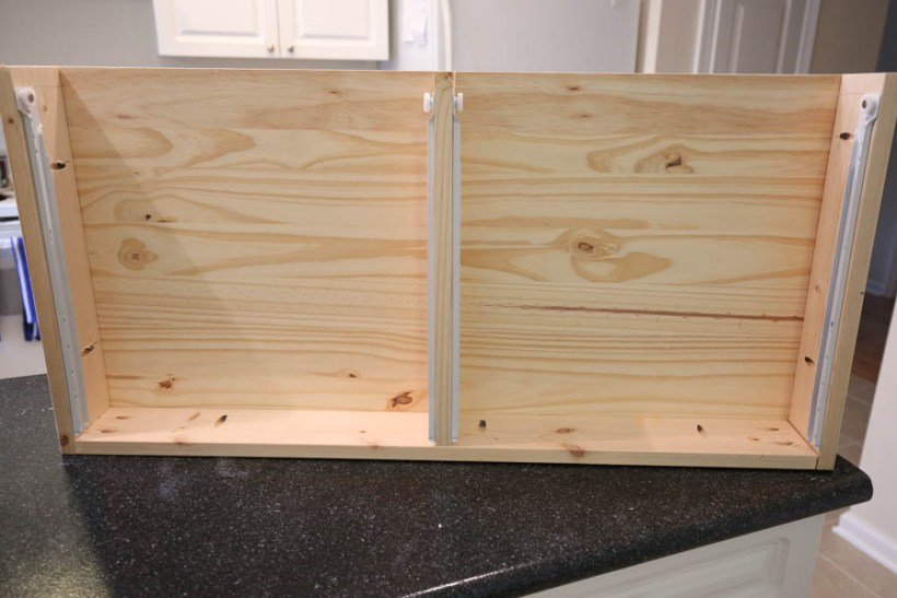 All four drawer slides attached to interior sides of makeup vanity