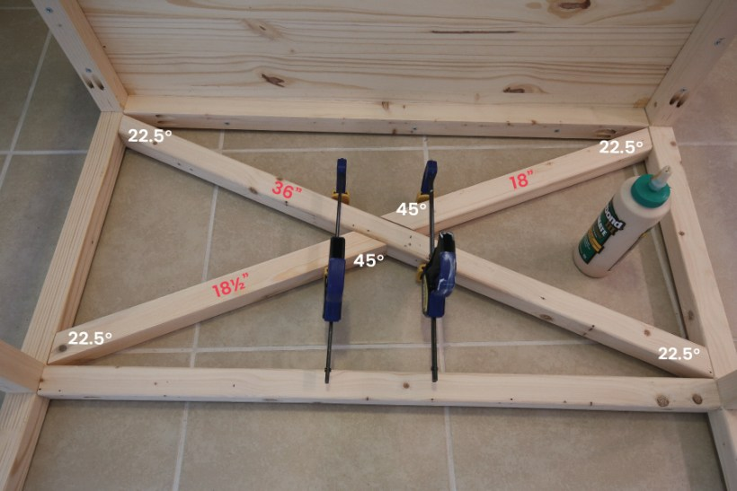 Attaching X style legs to DIY makeup vanity with wood glue and clamps