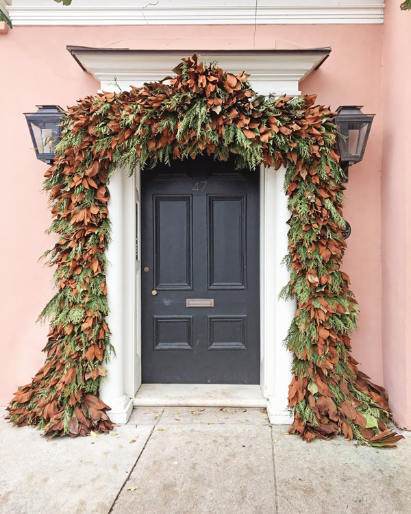 Magnolia and fresh pine garland over front door in Charleston for Christmas decor