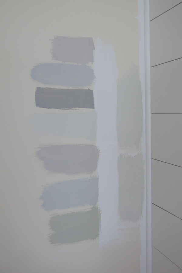 Testing paint samples on different walls and paint larger paint samples on wall for finall paint color options