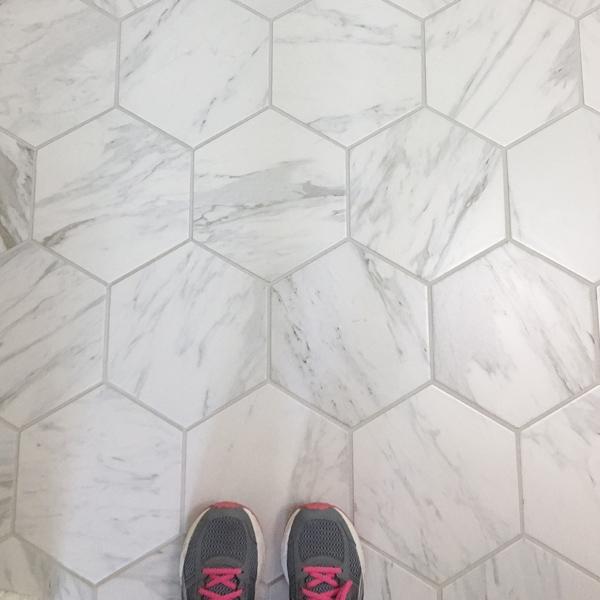 Hexagon Porcelain tile that looks like marble on a bathroom floor