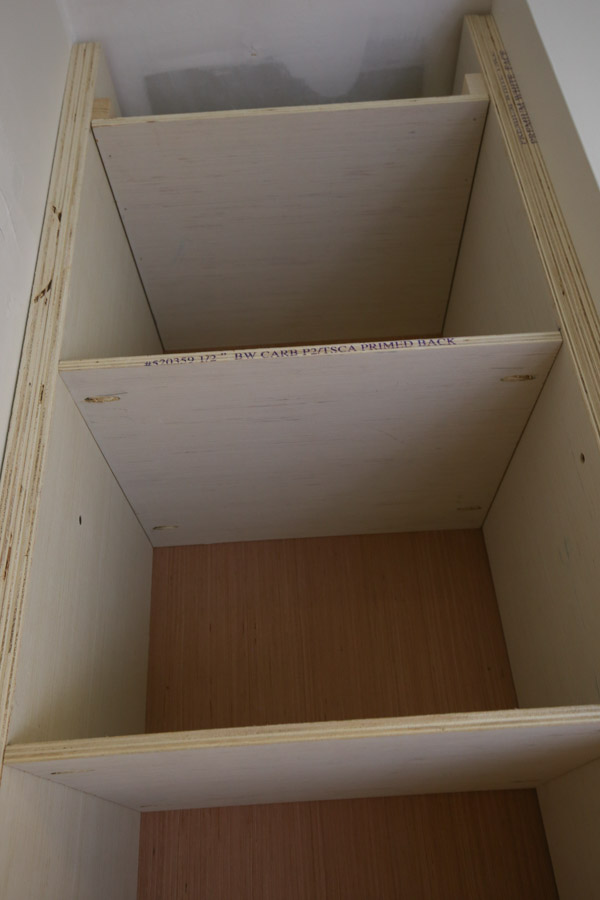 Attach the remaining shelves for the DIY built in with pocket holes and Kreg screws