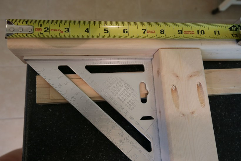 Attach longer boards to shorter boards to start making side couch frames