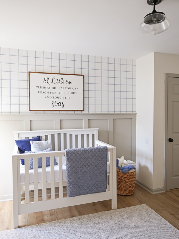 nursery accent wall with crib