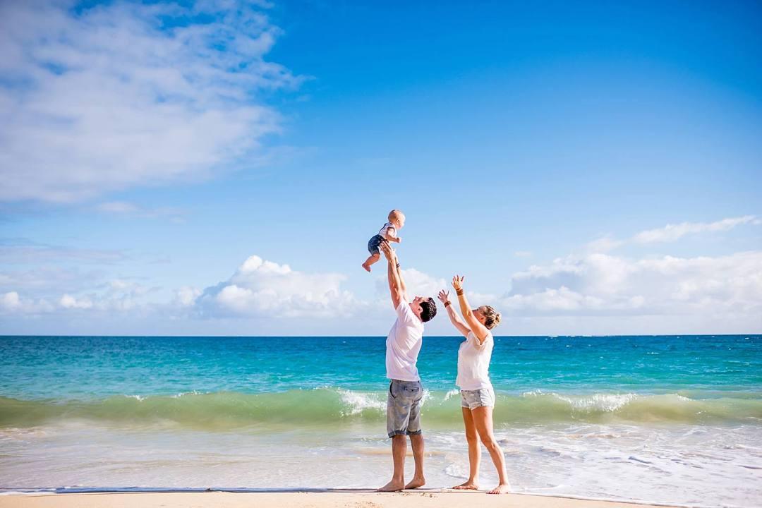 family on the beach in maui, hawaii