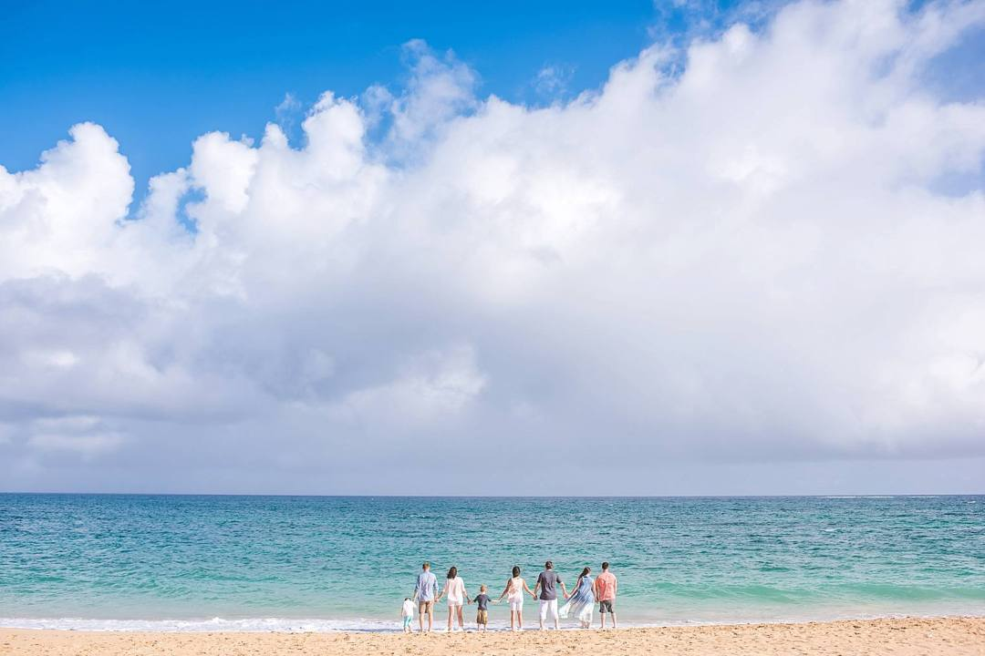 family at the beach together in Maui, hawaii