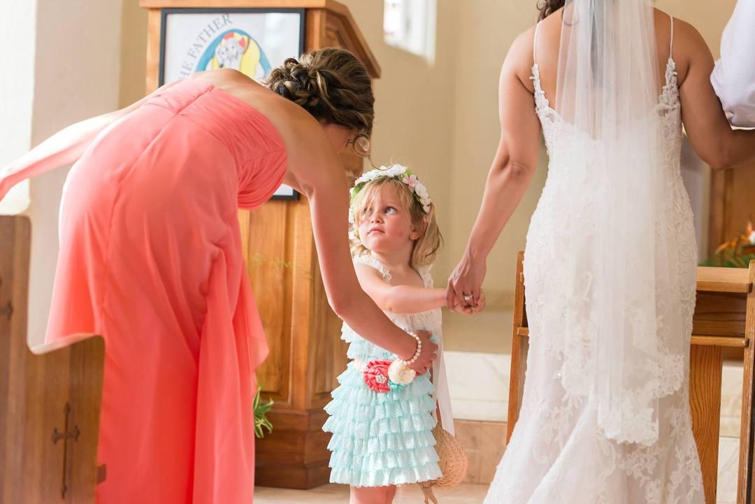 flower girl holding bride's hand