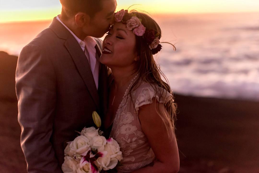 new husband kissing wifes forehead