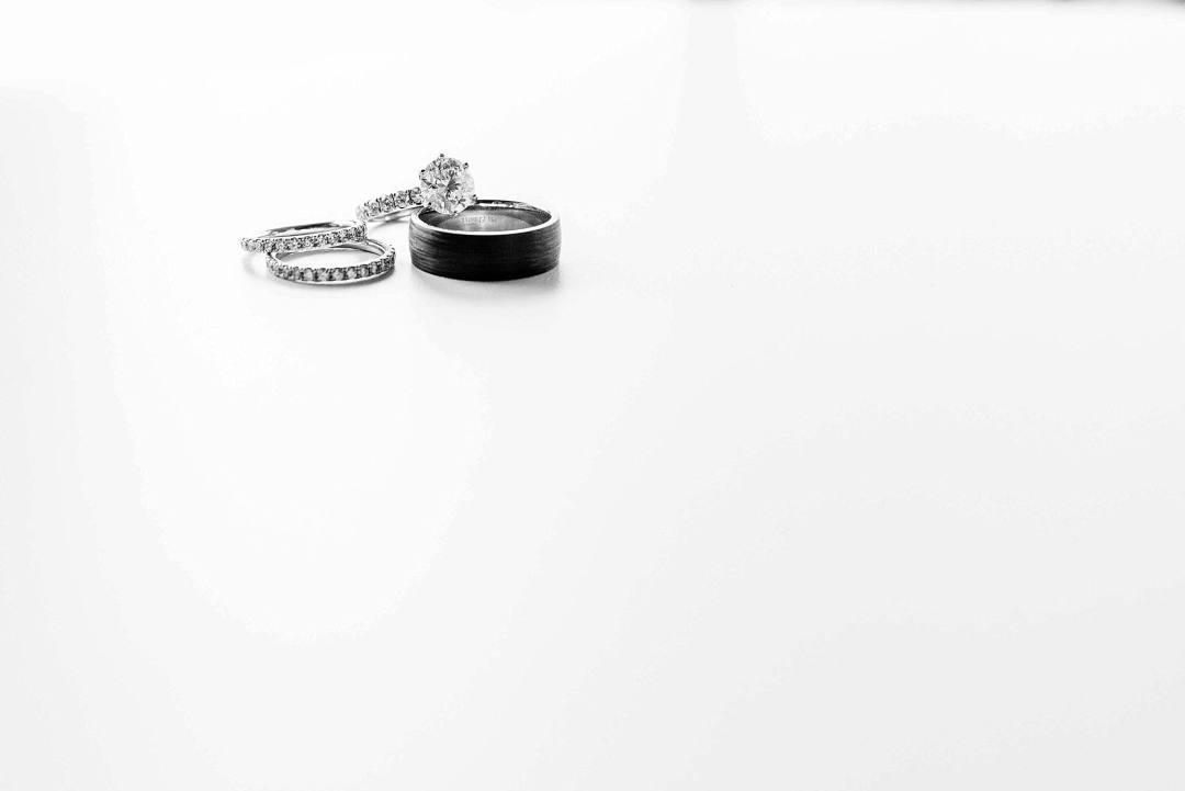 minimalist photo of wedding rings