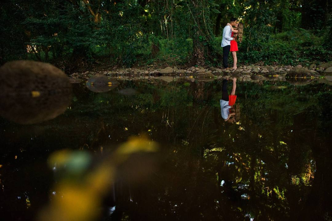 reflection in water of engaged couple in maui