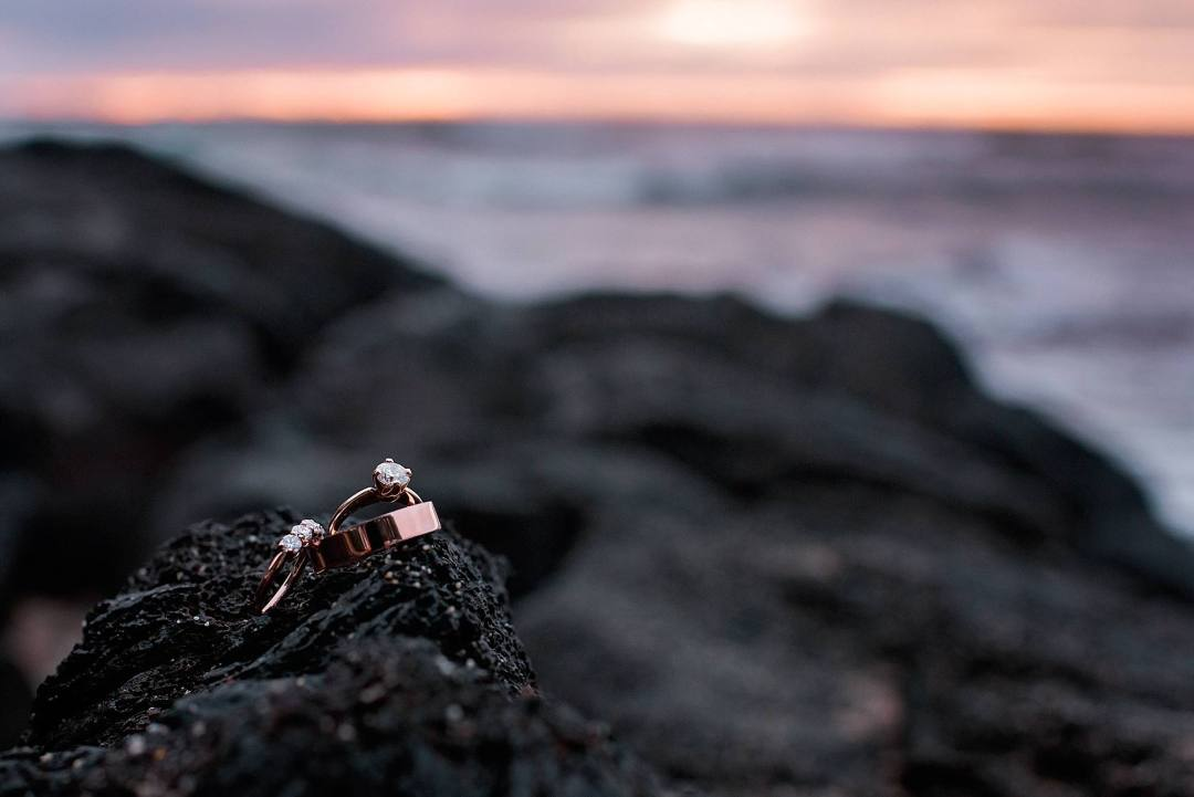 rose gold wedding rings at sunset