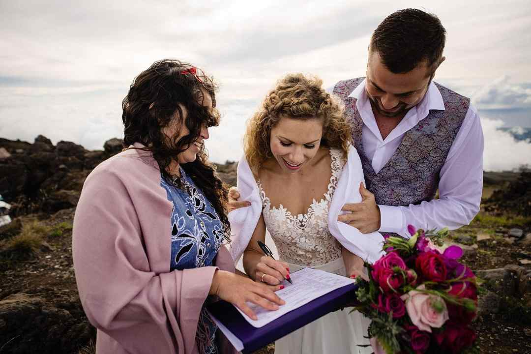 couple signing marriage cerificate