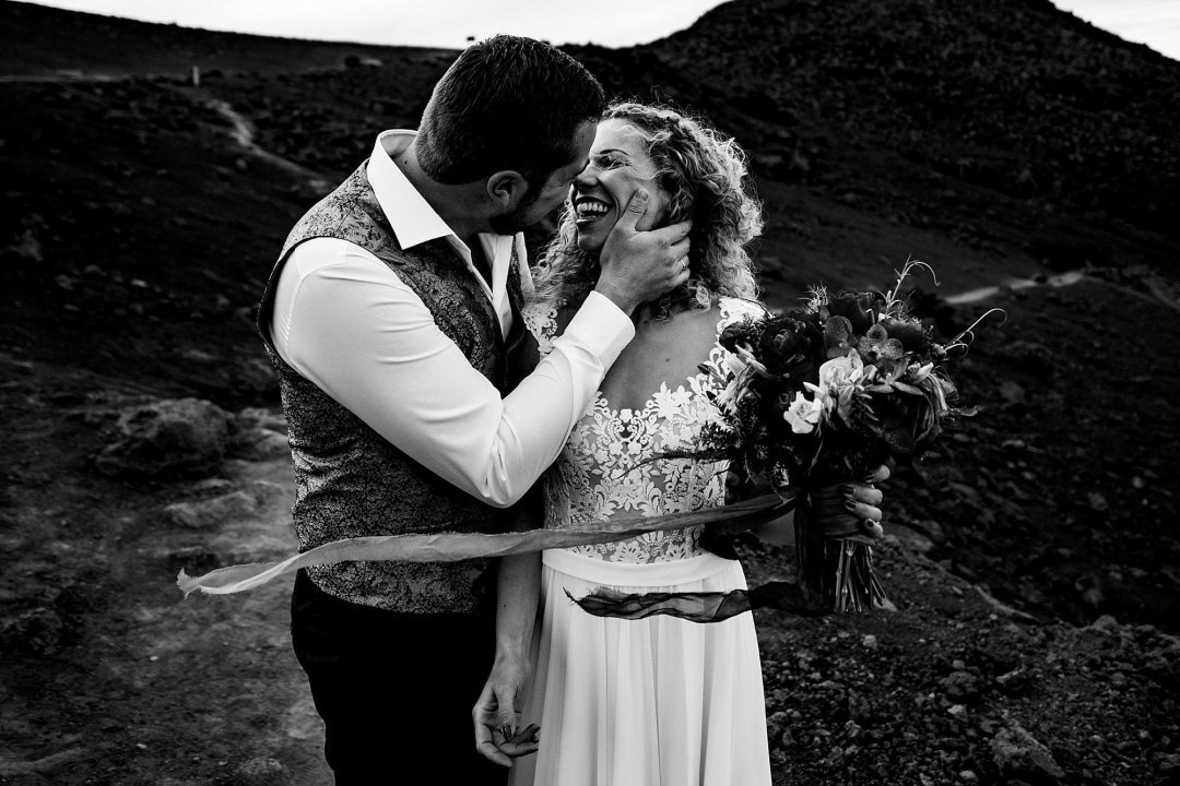 bride and groom kissing black and white haleakala