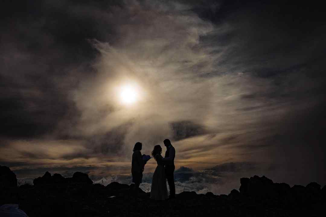 silhouette of bride and groom on volcano