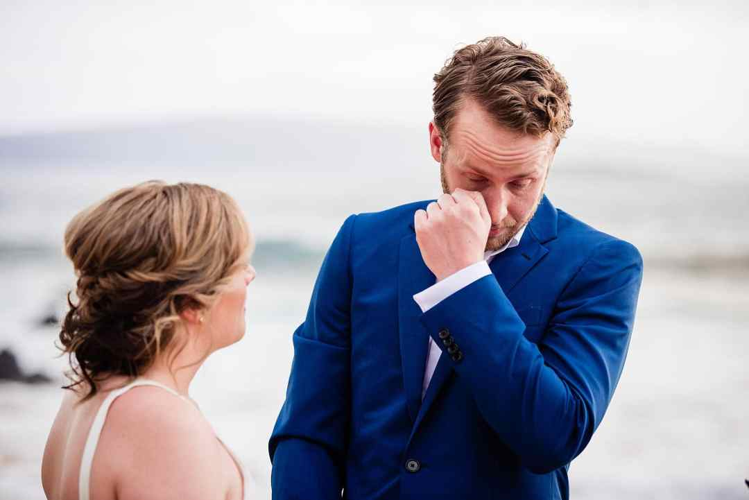 emotional photo of groom on wedding day