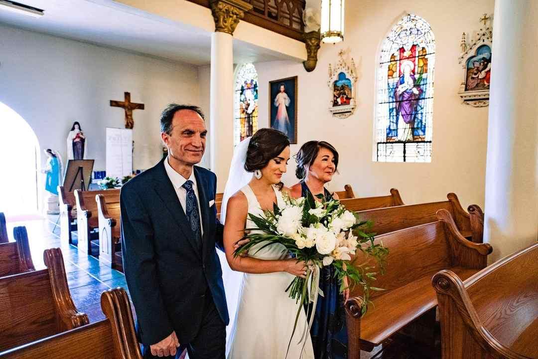 bride walking down the aisle at st.joseph church in makawao