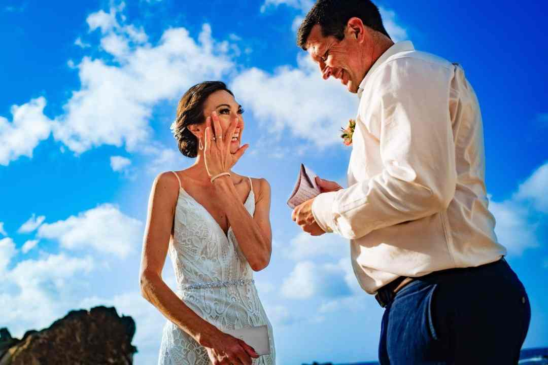 bride wiping tears during vows