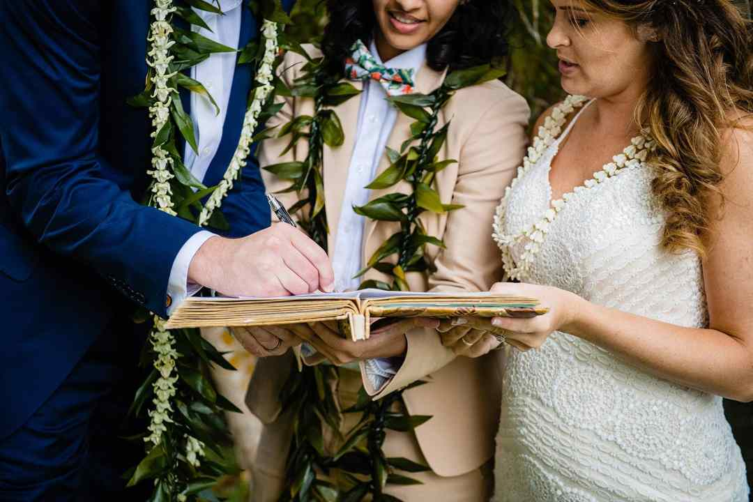 signing marriage document in maui