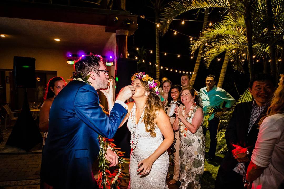 bride and groom feeding each other malasadas