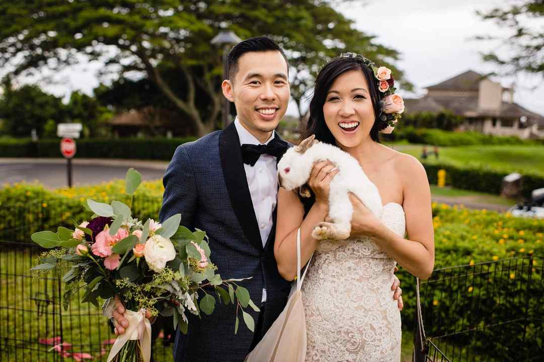 bride and groom portrait with white rabbit at Steeple House Kapalua