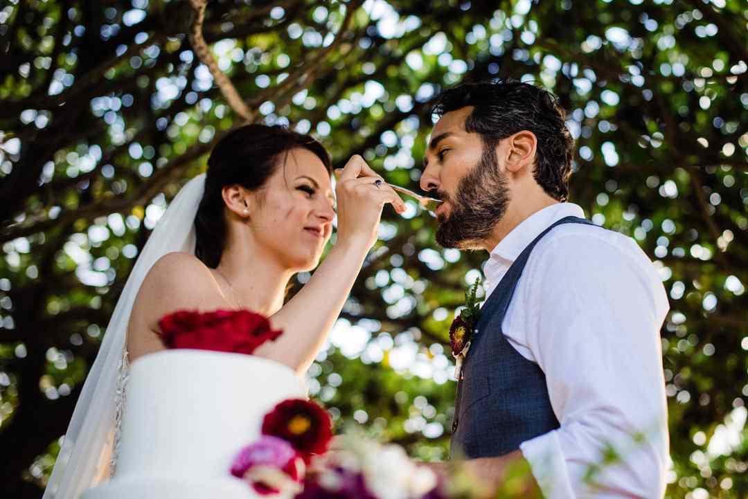 bride feeding the groom cake at kukahiko estate