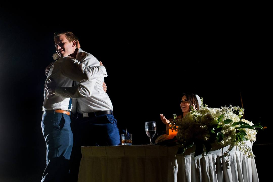 best man and groom hugging after speech