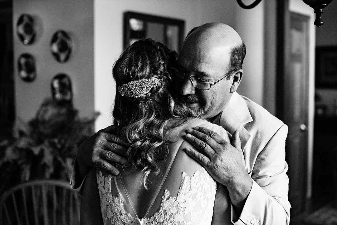 dad hugs bride after first look