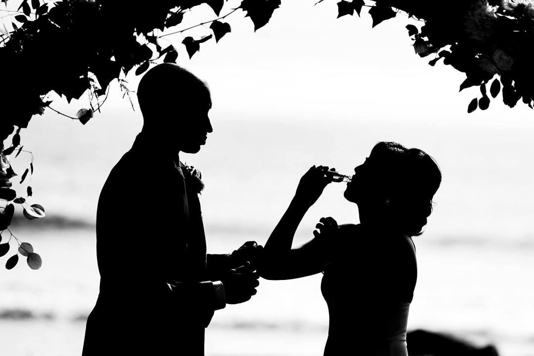 bride and groom taking shots during wedding at olowalu plantation house