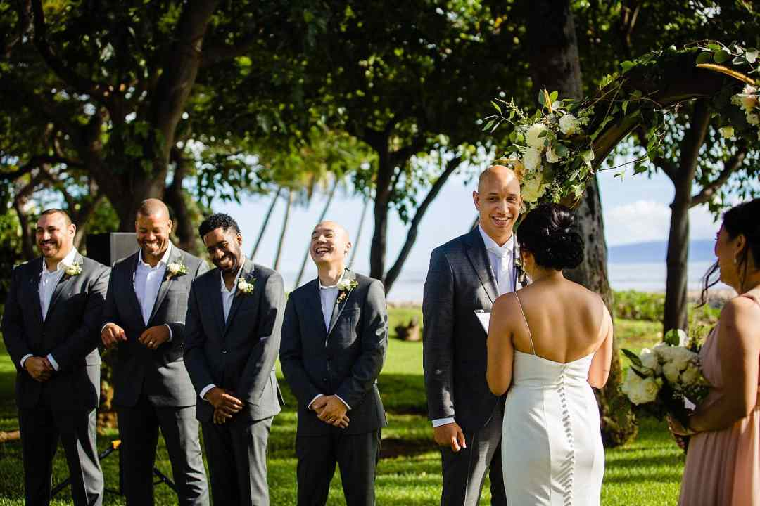 groomsmen laughing during destination wedding at olowalu plantation house