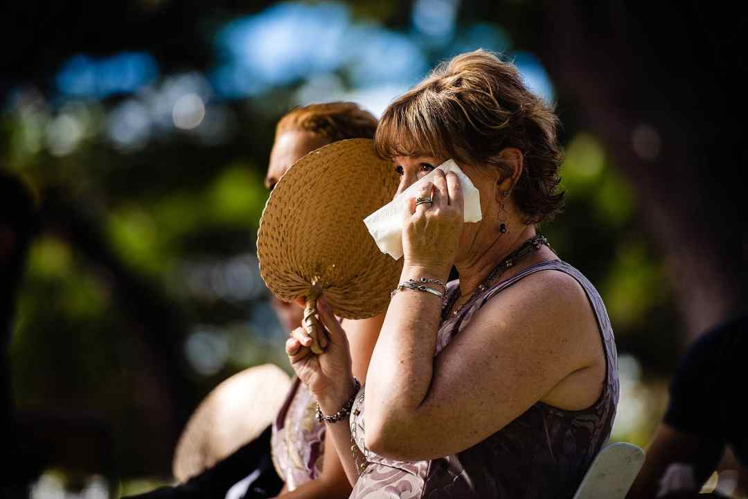 mom wiping tears during wedding at olowalu plantation house