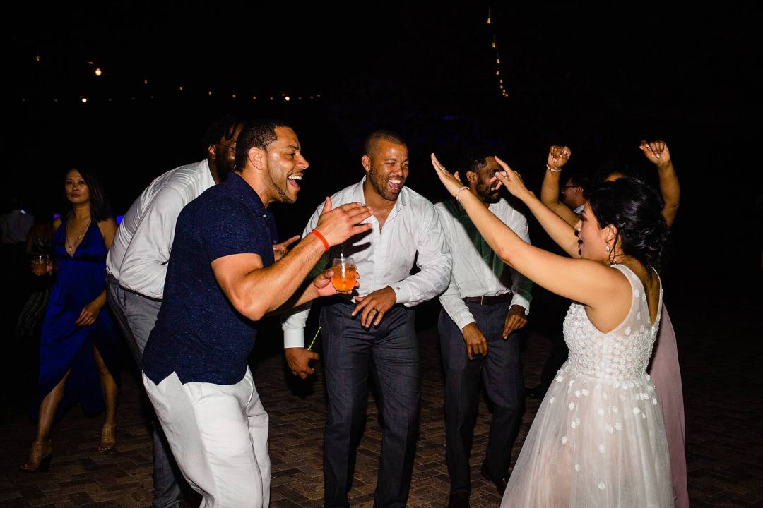 bride dancing with guests at destination wedding at olowalu plantation house